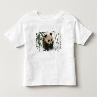 Panda cub on snow, Wolong, Sichuan, China 2 Toddler T-shirt