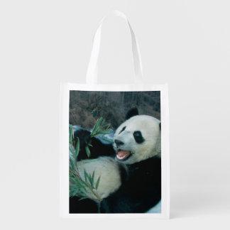 Panda eating bamboo by river bank, Wolong, 2 Market Totes