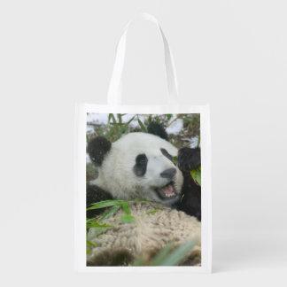 Panda eating bamboo on snow, Wolong, Sichuan, Reusable Grocery Bag