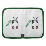 Panda que come el folio de bambú del carrito planificador