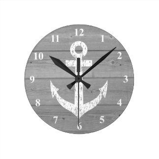 Paneles náuticos del ancla y de madera del barco reloj