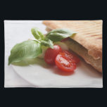 """Panini Caprese italian food placemat<br><div class=""""desc"""">Placemat with healthy Italian food consisting of a panini sandwich and a tomato,  green basil leaves and mozzarella cheese (Panini Caprese) on a white background.</div>"""
