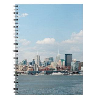Panorama of Midtown Manhattan over Hudson River Spiral Notebooks