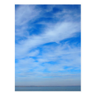 Panorama of the sky over the lake of white cirrus postcard