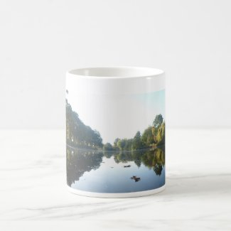 Panoramic Autumn Trees on Waterfront Coffee Mug