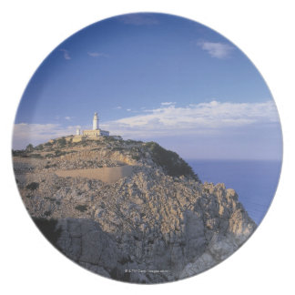panoramic view of a light house on a cliff dinner plate
