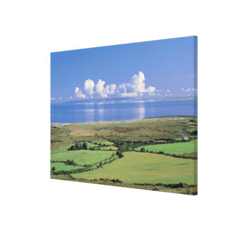 panoramic view of farm fields near the lake stretched canvas prints