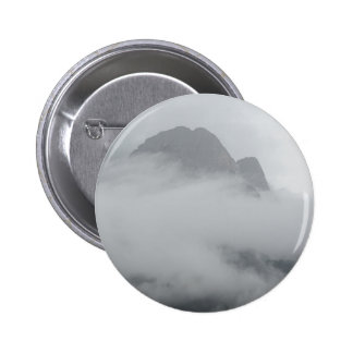 Panoramic view of mountains in the fog button