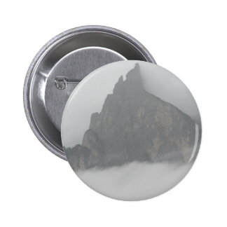 Panoramic view of mountains in the fog pinback button