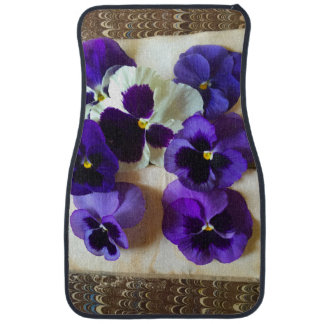 Pansies on an old book car floor mat