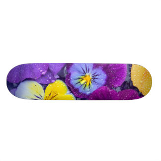 Pansy flowers floating in bird bath with dew 2 skateboard deck