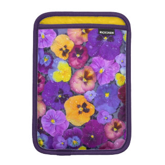 Pansy flowers floating in bird bath with dew iPad mini sleeve