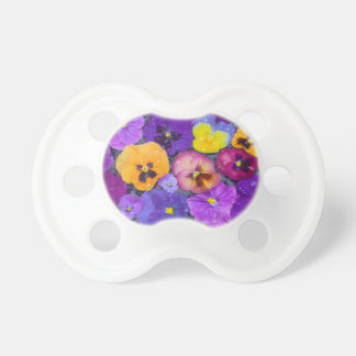 Pansy flowers floating in bird bath with dew pacifier