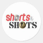 Pantalones cortos y tiros pegatina redonda