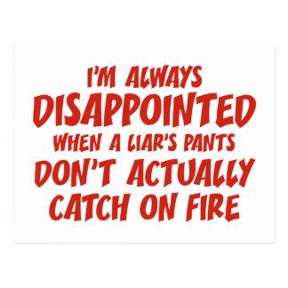 Pantalones del mentiroso del mentiroso en el fuego postal