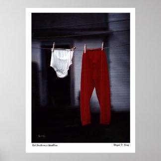 Pantalones rojos en un washline póster