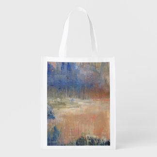 Pantano de la puesta del sol bolsas de la compra