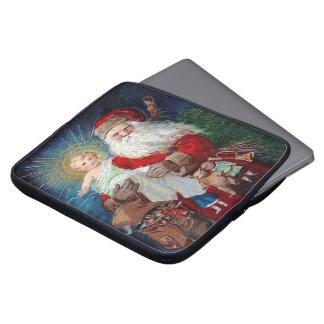 Papá Noel con el niño de Cristo Fundas Portátiles