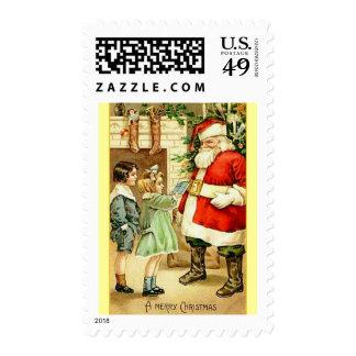 Papá Noel con franqueo de 2 niños