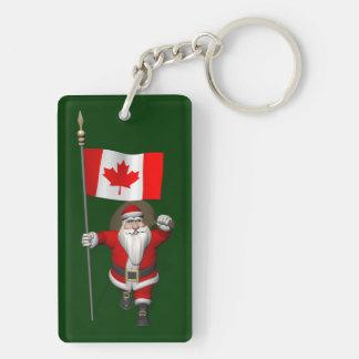 Papá Noel con la bandera de Canadá Llavero Rectangular Acrílico A Doble Cara