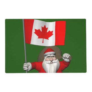 Papá Noel con la bandera de Canadá Tapete Individual