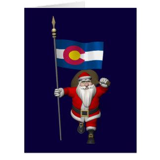 Papá Noel con la bandera de Colorado Felicitaciones