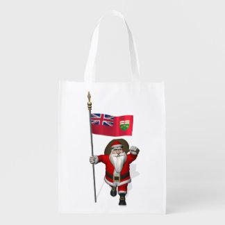 Papá Noel con la bandera de Ontario CDN Bolsa Reutilizable