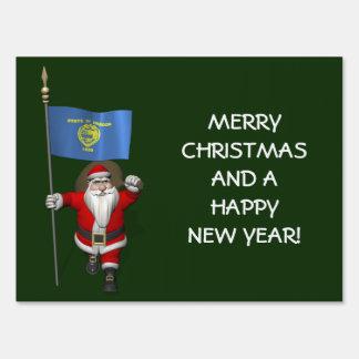 Papá Noel con la bandera de Oregon Carteles