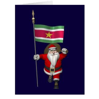Papá Noel con la bandera de Suriname Tarjetón