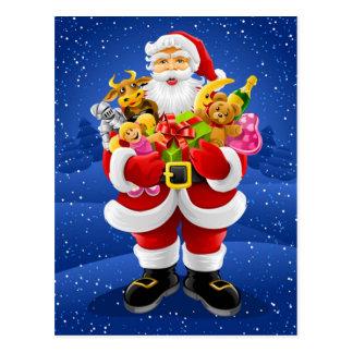 Papá Noel con los juguetes Postal