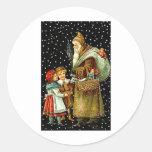 Papá Noel con los niños Pegatinas Redondas