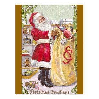 Papá Noel con un saco lleno de juguetes Postal