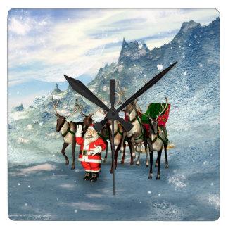 Papá Noel divertido con el reno y el trineo Reloj Cuadrado