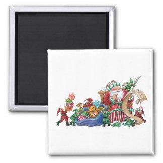 Papá Noel, duendes y juguetes para el imán del nav
