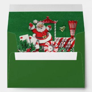 Papá Noel en el tren del navidad del caramelo de Sobre