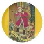 Papá Noel en las Felices Navidad de la puerta Platos