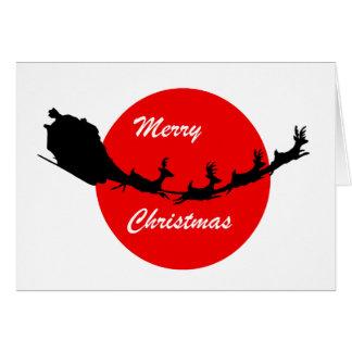 Papá Noel en su engranaje del navidad del trineo Tarjetón