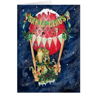 Papá Noel está viniendo a la tarjeta de la ciudad