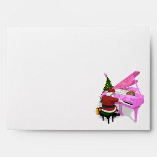Papá Noel juega el piano rosado