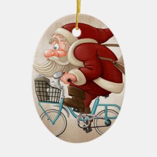 Papá Noel monta la bicicleta Adorno Navideño Ovalado De Cerámica