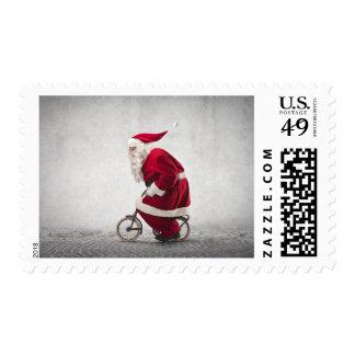Papá Noel monta una bicicleta Estampillas