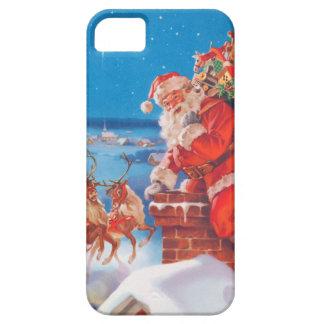 Papá Noel para arriba en el tejado con su reno iPhone 5 Fundas