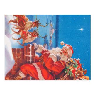 Papá Noel para arriba en el tejado con su reno Postal