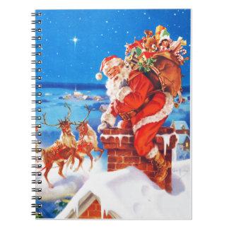 Papá Noel para arriba en el tejado en la nieve Libretas Espirales