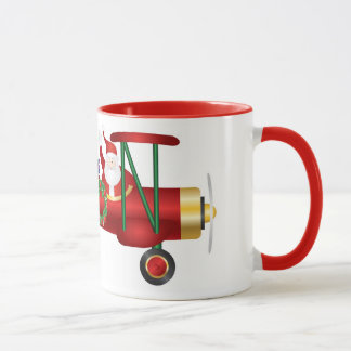 Papá Noel que agita en el biplano con la taza de