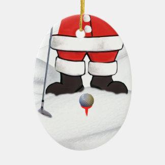 Papá Noel que juega a golf en la nieve Adorno Navideño Ovalado De Cerámica