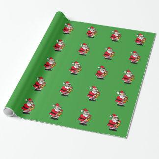 Papá Noel que juega el papel de embalaje del