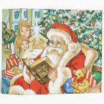 Papá Noel que lee la biblia el Nochebuena