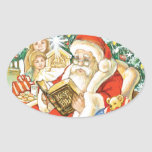 Papá Noel que lee la biblia el Nochebuena Pegatina Ovalada