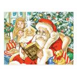 Papá Noel que lee la biblia el Nochebuena Postal